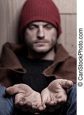 Begging homeless man
