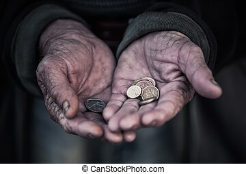 Begging - The man is begging for money, because of hunger.