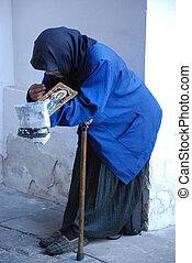 Begging woman near monastery entrance, Kazan, Russian...