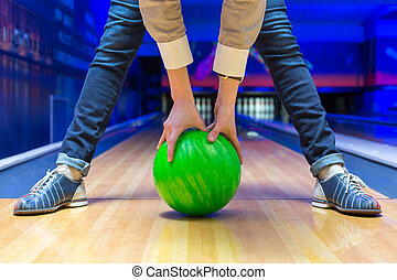 Beginner aiming to bowling pins - Funny beginner woman...
