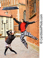 Beginner photographer with digital camera and funny guy with umbrella