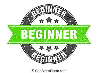 beginner round stamp with green ribbon. beginner