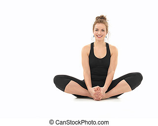 beginner yoga practice - young girl smiling, demonstrating...