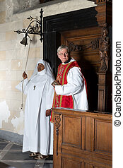 Beginning of catholic mass - Nun ringing a bell at the ...