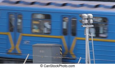 Beginning of city life in Kiev, the capital of Ukraine. Metro Train goes out of the tunnel. A blue train leaving a tunnel with high speed. Subway Train Moving Out with of Tunnel on the Outside City