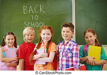 Beginning of school year - Portrait of friendly classmates...
