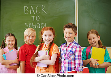 Beginning of school year - Portrait of friendly classmates ...