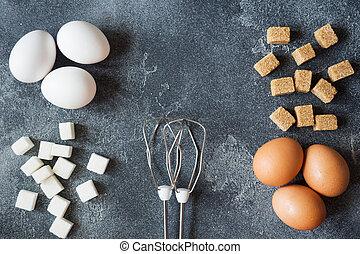 begriff, von, hauptkochen, eier, und, zucker, mit, a, wischen, auf, a, dunkel, tisch, vorgewählter fokus