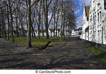 Beguinage Bruges, Belgium. - View of the courtyard of the ...