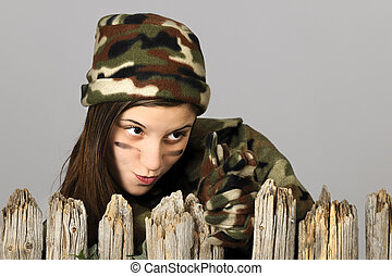 Behind a Fence in Camo