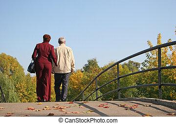 behind couple on autumn bridge