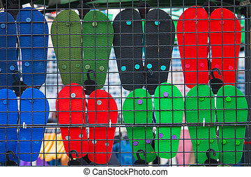 Behind of sandal rubber hang on cage in market