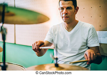 Behind scene. Drummer artist musician playing the drums with...