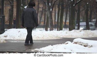 behind senior man on winter street - Behind of senior man on...