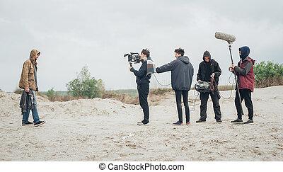 Behind the scene. Film crew filming movie scene outdoor -...