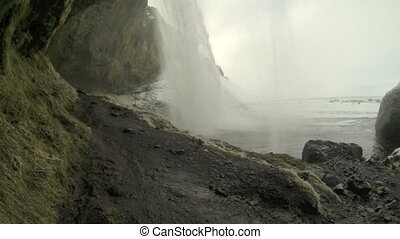 Behind the waterfall Seljalandsfoss - Video filmed from...