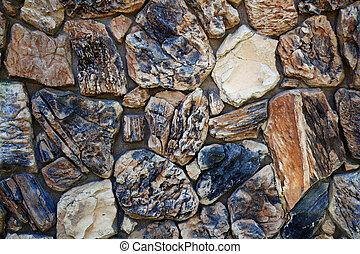 Beige and black stone wall