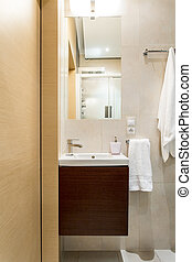 Beige and brown bathroom design