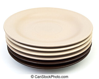 saucers - beige and brown saucers against the white...
