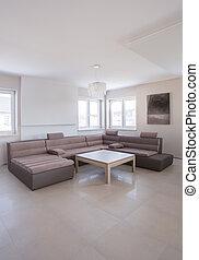 Beige angular sofa in luxury drawing room