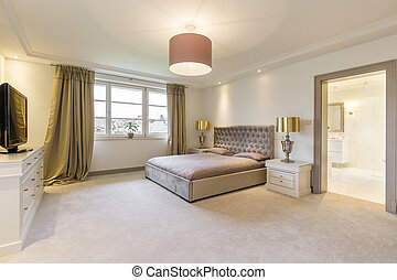 Beige bedroom with a large bed