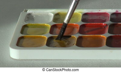 beige color. close up. Artist works with brush and...