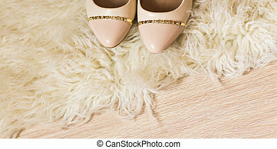 Beige female shoes. top view