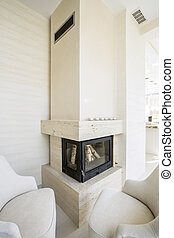 Beige fireplace in elegant home