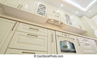 Beige kitchen details shown from lower point of view - Beige...
