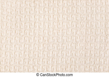 Beige knitted fabric texture background. Close-up