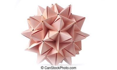 Beige origami transforming spiky ball. Origami exhibition,...