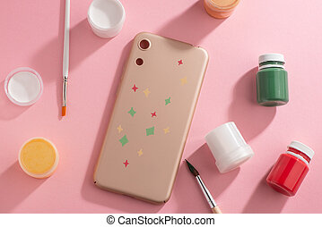 Beige phone case decorated with hand-painted stars