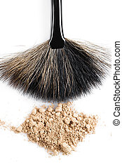 Beige powder for face and makeup brush isolated on white background