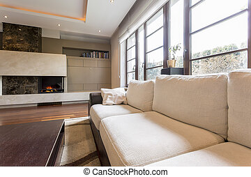 Beige sofa in sitting room - Comfortable beige sofa in...