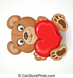Beige teddy bear holding a heart isolated on white background