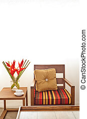 Beige upholstered chair in interior seting