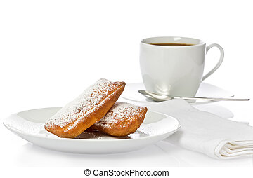Beignets - Two New Orlean style beignets with a cup of ...