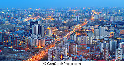 Beijing at night aerial view with urban buildings.