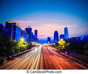 beijing central business district with traffic in nightfall, China
