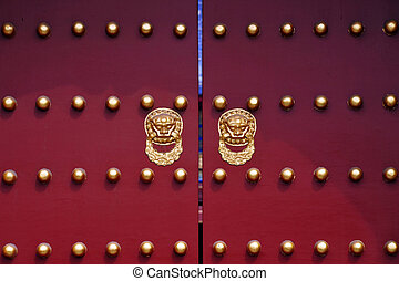 An Art decorated door with gold doors handles in The Temple of Heaven complex.