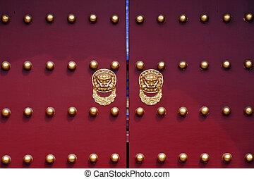 Beijing China - An Art decorated door with gold doors...