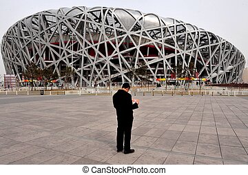 Beijing China - Chinese people are visiting at the bird nest...