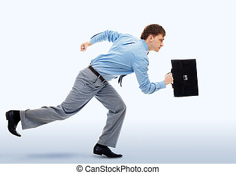 Being late - A businessman running in office building
