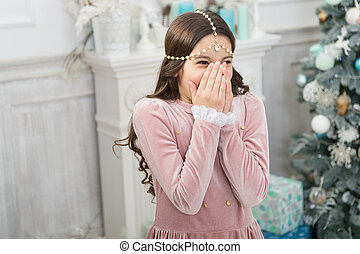 being surprised. christmas home decoration. xmas shopping. awaiting new year. pretty little princess celebrate christmas. smiling cute child at home. happy new 2020 year. holiday party celebration