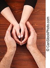 Man's hands over woman's
