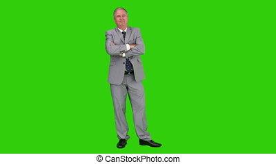 bejaarden, zakenman, in, een, grijs kostuum, kijken naar van het fototoestel