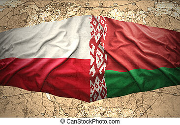 Waving Belorussian and Polish flags of the political map of the world