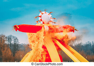 Belarus. Burning Effigies Straw Maslenitsa In Fire On Traditional National Holiday Dedicated To Approach Of Spring - Slavic Celebration Shrovetide