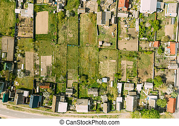 Belarus, Europe. Aerial View Of Small Town, Village Cityscape Skyline In Summer Day. Residential District, Houses And Vegetable Garden Beds In Bird's-eye View
