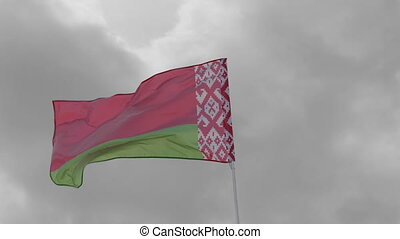 Belarus flag on the flagpole waving in the wind against a...